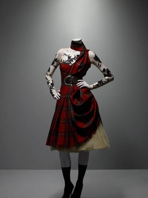 Alexander McQueen (British, 1969–2010).  Ensemble, Widows of Culloden, autumn/winter 2006–7.  Dress of McQueen wool tartan; top of nude silk net appliquéd with black lace; underskirt of cream silk tulle.  Courtesy of Alexander McQueen.  Photograph © Sølve Sundsbø / Art + Commerce