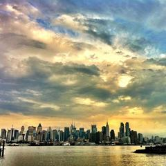 The New York City skyline after a stormy afternoon from Port Imperial, NY Waterway in Weehawken New Jersey.