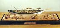 "This model of the Beetle Whaleboat is produced completely in wood.  The model overall length which include the steering oar is 14"" inches.  The scale is 1:32, 3/8"" = 1'."