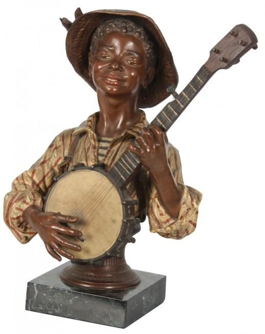 This cold painted figural bust of a black boy wearing a straw hat and 19th century French garb will be sold Saturday, September 13th.