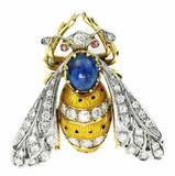 "This 18kt gold, diamond and enamel ""Bee"" brooch, centered by an oval cabochon sapphire, will be sold Sunday, December 15th."