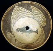 Prehistoric Mimbres Indian pottery bowl with probe hole at bottom and original fish design.