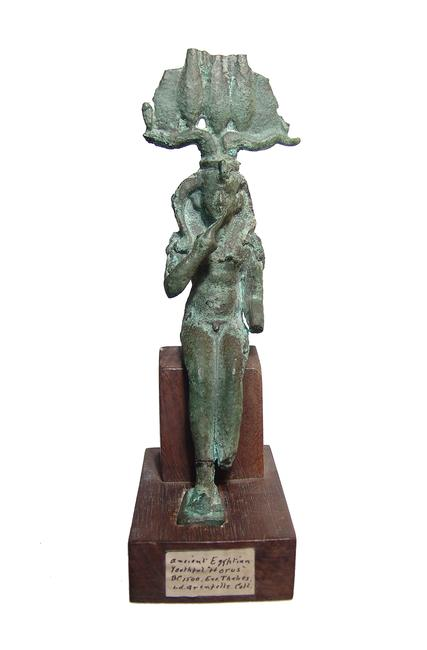 Bronze figure of Harpokrates – the Greek god of silence, secrets and confidentiality – wearing a Hem Hem crown and side-lock, 6 ½ inches tall on an antique wooden base (est.  $700-$1,000).