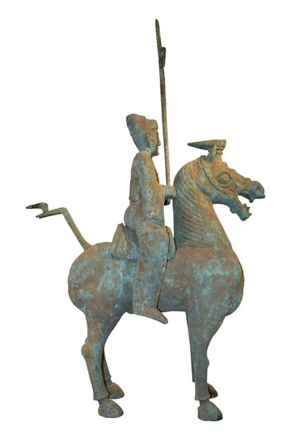 Massive archaic Chinese bronze statue of man on horseback.  Eastern Han Dynasty.