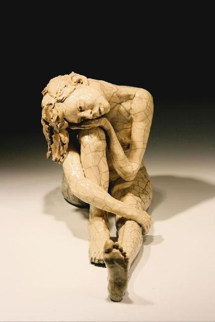 """Woman, Head on Knee,"" (large) by Bob Clyatt, Raku-fired stoneware.  15""H x 26""L x 8""W clyattsculpture.com"