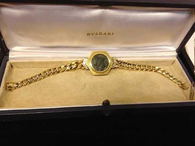 This stunning Bvlgari 18kt gold and diamond bracelet with an ancient coin at the center will be auctioned Nov.  17th.