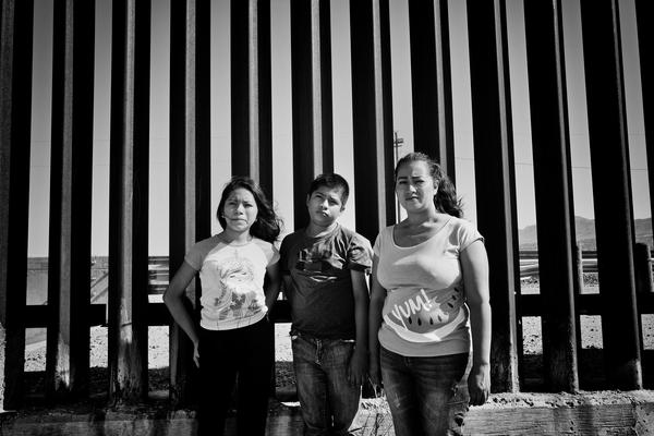 Candy at the Wall | Candy, pictured with her son and daughter, was sexually assaulted and her family constantly threatened by gangs in Guatemala.  She was granted asylum on September 6th ahead of the September 11th Supreme Court ruling.  She is reunited with her husband.  Her daughter who is now 18 and considered an adult, must wait for her own court date.  Ada Trillo keeps in constant touch with Candy.