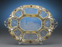This resplendent Viennese charger is inset with nine intricately engraved panels of rock crystal