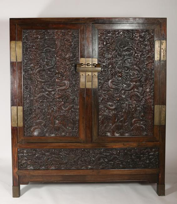 An 18th century Chinese Zitan Cabinet with Dragon Carved Panels, with later additions