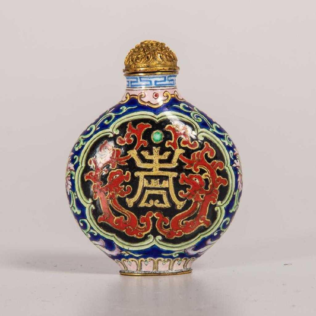 Chinese Qianlong period porcelain enamel snuff bottle with four-character Qianlong mark in a double square in blue enamel on the base, decorated in colors over a navy-blue ground (est.  $8,000-$10,000).