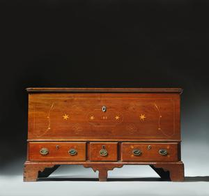 "INLAID CHIPPENDALE BLANKET CHEST.  Pennsylvania, dated 1818, walnut and pine.  Dovetailed chest over three drawers on bracket feet and an interior till.  Decorated with tulip, star, and fylfot inlay.  Retains original brasses, hinges, and finish.  29.5""h.  49.5""w.  23""d.  Estimate $ 4,000-8,000"