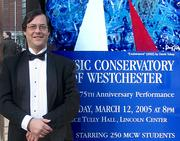 "Painter and sculptor David Tobey, who is also a professional violinist at Lincoln Center where he conducted part of a concert by students of the Music Conservatory of Westchester on the occasion fo their 75th Anniversary in 2005.  Tobey's painting ""Exuberance"" was used as the cover for the Alice Tully Hall performance and as this poster for the event at Lincoln Center."