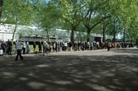Queues outside Art Antiques London, Kensington Gardens, London waiting for entrance to the fair