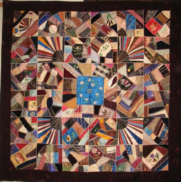 Persian blue medallion with floral embroidery crazy quilt.