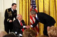 Financier and philanthropist Roy Neuberger receiving the National Medal of Arts from US President George W.  Bush in 2007.
