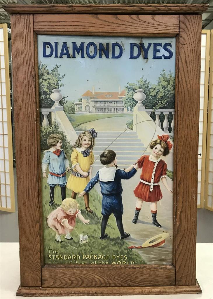 Diamond Dyes oak general store cabinet, one of the many rare, old and beautiful antique advertising pieces in the auction.