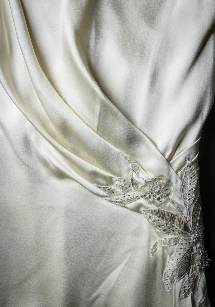 Detailed view of Edith's wedding dress.  Cosprop Ltd., London.  All Rights Reserved.