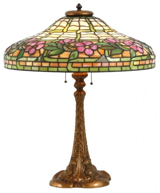 Duffner & Kimberly table lamp with 20-inch diameter leaded shade having a green and caramel slag background, 24 inches tall (est.  $4,000-$6,000).
