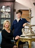 "Garth's co-owner & President, Amelia Jeffers(standing right) and Gemologist/Appraiser Lisa Darke pose in Garth's gallery with the monumental English silver centerpiece to sell February 4 (estimate $12,000-$18,000).  On January 31st, the duo is hosting a girl's night out at Garth's called ""Bling & Beverages"", to introduce retail buyers to the benefits of buying at auction and allow extended preview hours of the Feb.  3-4 sales.  Email amelia@garths.com for complimentary tickets."
