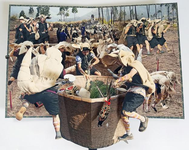 "Colette Fu, Photographic Pop-Up Book, Luoma, Yi Tiger Festival.  The Yi people from China's Yunan province, worship the tiger as their grandest totem.  disturbed by Under the direction of the black ""Tiger King,"" they offer sacrifice and dance to reflect the journey and way of life of the Yi people as they visit each house to guard the village from evils.  Thus ""Luoma,"" the Tiger Festival, was created to display the Yi people's tiger-like strength and valor."