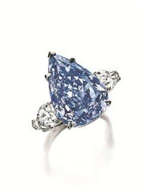 THE WINSTON BLUE A pear-shaped Fancy Vivid Blue Flawless Diamond of 13.22 carats sold for $23,795,372 at Christie's.