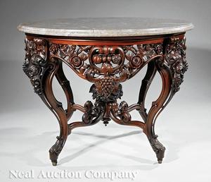Lot 157, a rare, American Rococo carved and laminated rosewood center table attributed to John Henry Belter.  Made c.  1850-60, this table closely relates to the example Belter constructed for the Lincoln bedroom at the White House.  The center table more than doubled its pre-sale low estimate of $25,000, selling for $86,637.00.