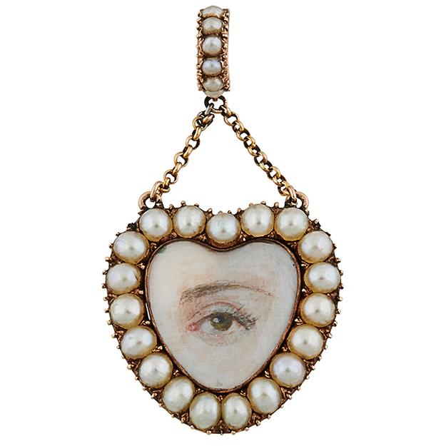 "Lover's Eye 19th century heart pendant, gold, seed pearls, glass, miniature painting of a hazel eye, braided human hair, 15/16""w x 1 3/4""h overall.  Estimated Value: $800 - $1,200.  Sold for $2,600"