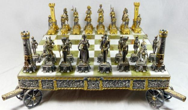 Beautiful gilt metal chess set and board by the Italian visual artist and sculptor Giuseppe Vasari (1934-2005), depicting the Battle of Waterloo, artist signed (est.  $2,000-$3,000).