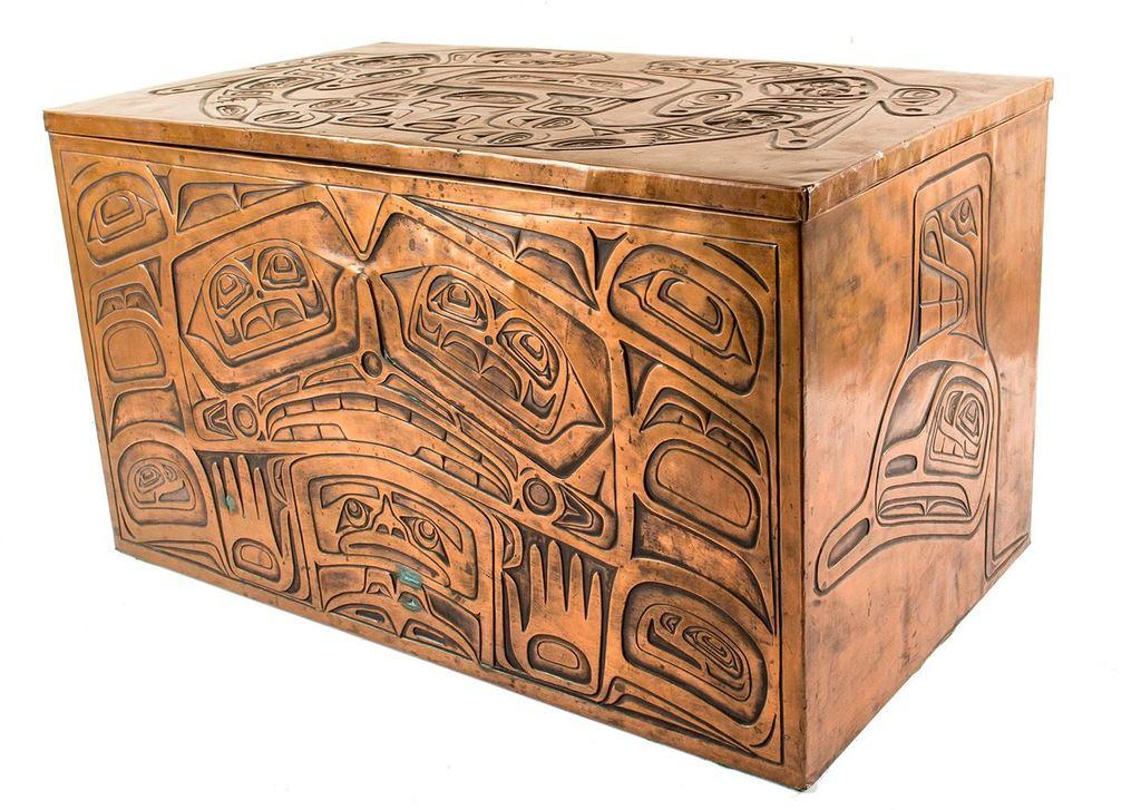 Stunning Haida hand-embossed copper over wood chest, lined in buskin and displaying elaborate Northwest Coast designs of animals, birds and sea creatures (est.  $1,000-$3,000).