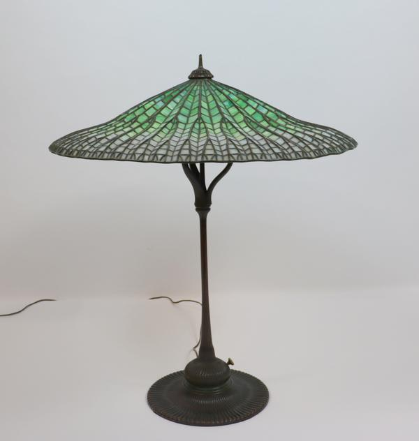 "From an important New York City collection comes a Tiffany table lamp with ""Lotus"" shade, signed ($125/225,000), 14 inches tall."