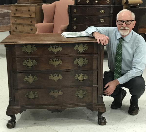 Partner Steve Fletcher with a Fine and Rare Chippendale Carved Mahogany Reverse Serpentine Bureau, coastal Massachusetts, c.  1760-80.  Sold for $291,000