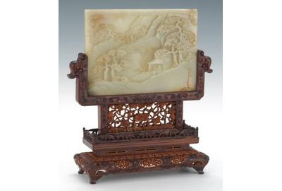 Lot 289.  Carved White Jade Screen in Boxwood Stand, ca.  1750