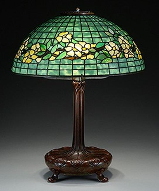 This Tiffany Studios Belted Dogwood table lamp is being offered at auction by James D.  Julia on June 18, 2015, with online bidding offered by Invaluable.com.