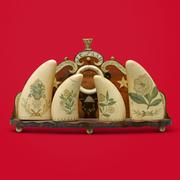 "Tommy Hilfiger: ""I was drawn to the scrimshaw pieces right away because I love Nantucket, Martha's Vineyard and that part of the world."" Rare and Important Carved Cherrywood, Scrimshaw and Tortoiseshell Marriage Mantle Ornament Initialed J.C.  and A.A.H., Circa 1870.  Estimate $15,000–25,000."