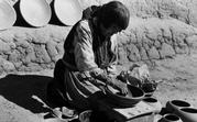 Laura Gilpin, Maria Martinez Making Pottery, 1959; Gelatin silver print, 10 3/4 x 14 1/2 in.; Eugene B.  Adkins Collection at Philbrook Museum of Art, Tulsa, and Fred Jones Jr.  Museum of Art, University of Oklahoma, Norman; © 1979 Amon Carter Museum of American Art, Fort Worth, Texas, L2007.0788