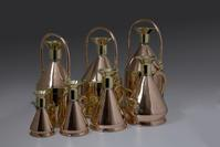 SEVEN COPPER AND BRASS PETROL MEASURES ..BY GASKELL & CHAMBERS LTD., BIRMINGHAM, EARLY 20TH CENTURY.