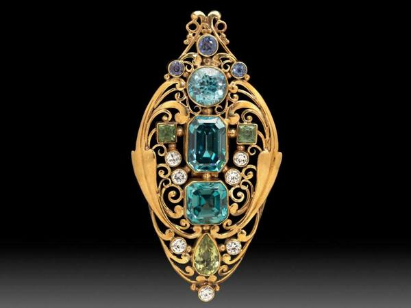 Frank Gardner Hale, jeweled scroll brooch, about 1920.  Gold, zircon, diamond, sapphire, peridot.  Gift of Joseph B.  and Edith Alpers.
