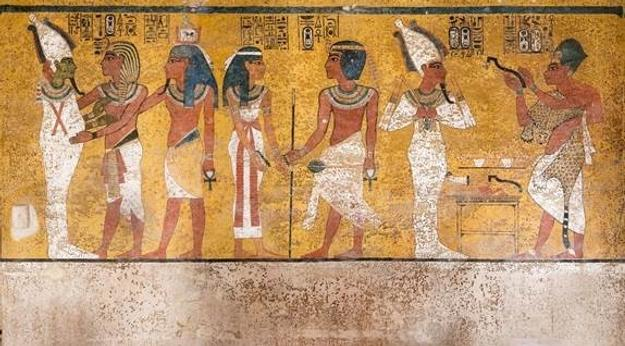 "The north wall of the burial chamber depicts three separate scenes, ordered from right to left.  In the first, Ay, Tutankhamen's successor, performs the ""opening of the mouth"" ceremony on Tutankhamen, who is depicted as Osiris, lord of the underworld.  In the middle scene, Tutankhamen, dressed in the costume of the living king, is welcomed into the realm of the gods by the goddess Nut.  On the left, Tutankhamen, followed by his ka (spirit twin), is embraced by Osiris."