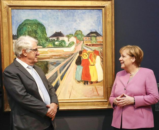 "Billionaire SAP co-founder Hasso Plattner and Chancellor Dr.  Angela Merkel in front of Edvard Munch's ""Girls on the Bridge"" at Museum Barberini.  The painting sold for $54.5 million at Sotheby's in Nov.  2016."