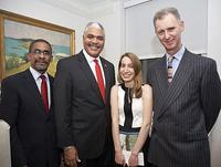 Jennifer Krieger standing with His Excellency the Governor of Bermuda, The Hon.  George Fergusson; Premier, The Hon.  Craig Cannonier, JP MP; and Gary L.  Phillips OBE JP