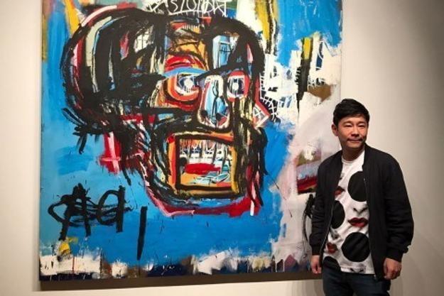 Yusaku Maezawa poses with Basquiat's Untitled (1982).
