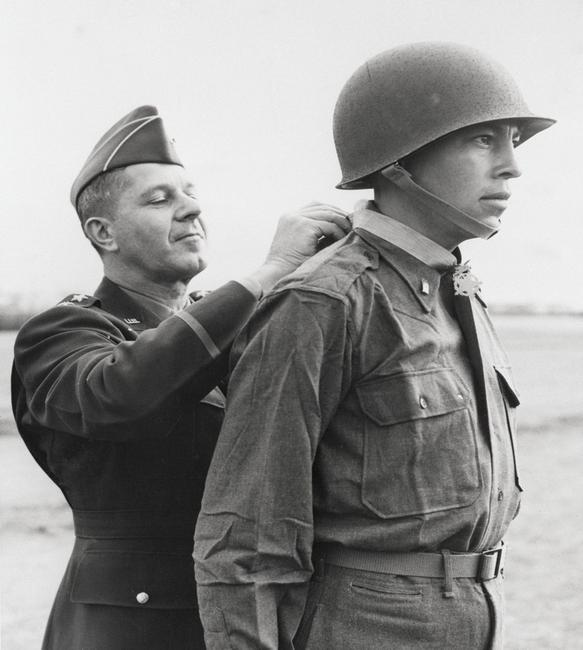 Ernest Childers (Muscogee [Creek]) receives the Congressional Medal of Honor from Lieutenant General Jacob L.  Devers (left).  5th Army headquarters, April 8, 1944.