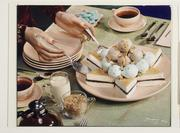 "Nickolas Muray, ""Table set for dessert, hands with silver utensils serving cake with ice cream"" (1944) (George Eastman Museum, gift of Mrs.  Nickolas Muray.  © Nickolas Muray Photo Archives)"