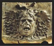 Medusa (circa 1480), a terracotta relief, by Andrea del Verrocchio.