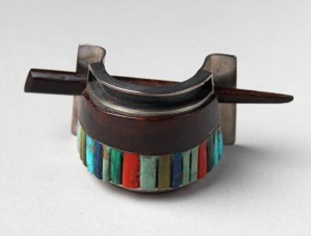 • Charles Loloma (1921 – 1991).  Hair ornament, Hopi, ca.  1980s.  Gift of Jo and Warren Buxton, Phoenix, Arizona.  NA.203.982
