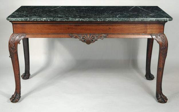 A rare Georgian marble top carved mahogany serving table brought $40,800 at Woodbury Auctions on June 8, 2014.