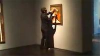 A YouTube frame shows the suit-jacketed suspect who spray-painted a Picasso at the Menil Collection in Houston.