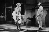 Marilyn Monroe wearing the iconic dress with its skirt billowing over a subway grate in the 1954 film The Seven Year Itch.