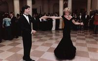 Princess Diana dancing with John Travolta.  Courtesy of Waddington's