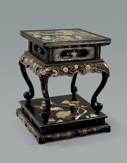 A late 17th to early 18th century Ryukyuan Mother-of-Pearl Inlaid Lacquer Stand Height: 39.7 cm.  (15 5/8 in.) Width at base: 31.7 cm.  (12 1/2 in.)